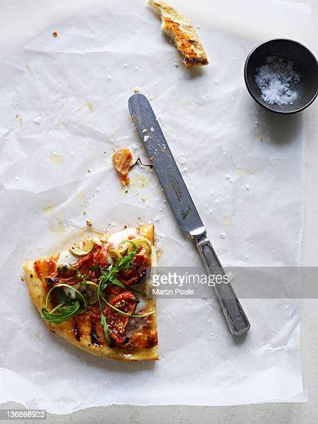 pizza slice on table - wax paper stock photos and pictures