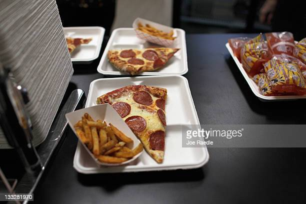 Pizza slices and french fries are seen as they are served during lunch at Everglades High School on November 18 2011 in Miramar Florida Monday...