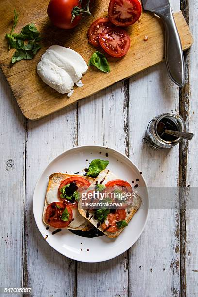 Pizza style toast with mozzarella, tomato and basil