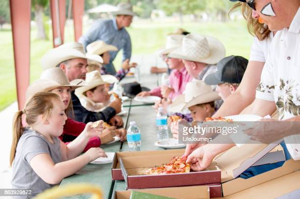pizza time for the rodeo team - paper plate stock photos and pictures