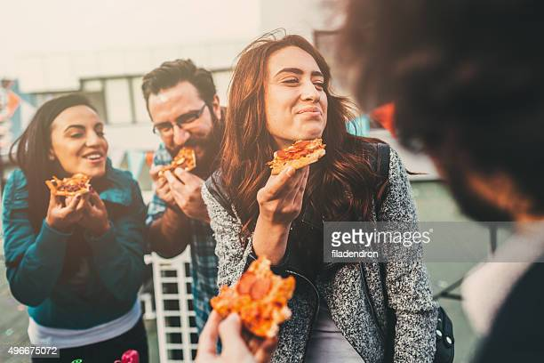 pizza time on the roof - pepperoni stock photos and pictures
