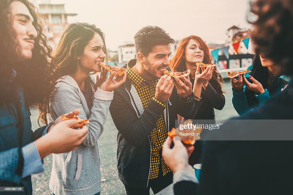 Pizza time on the roof : Stock Photo