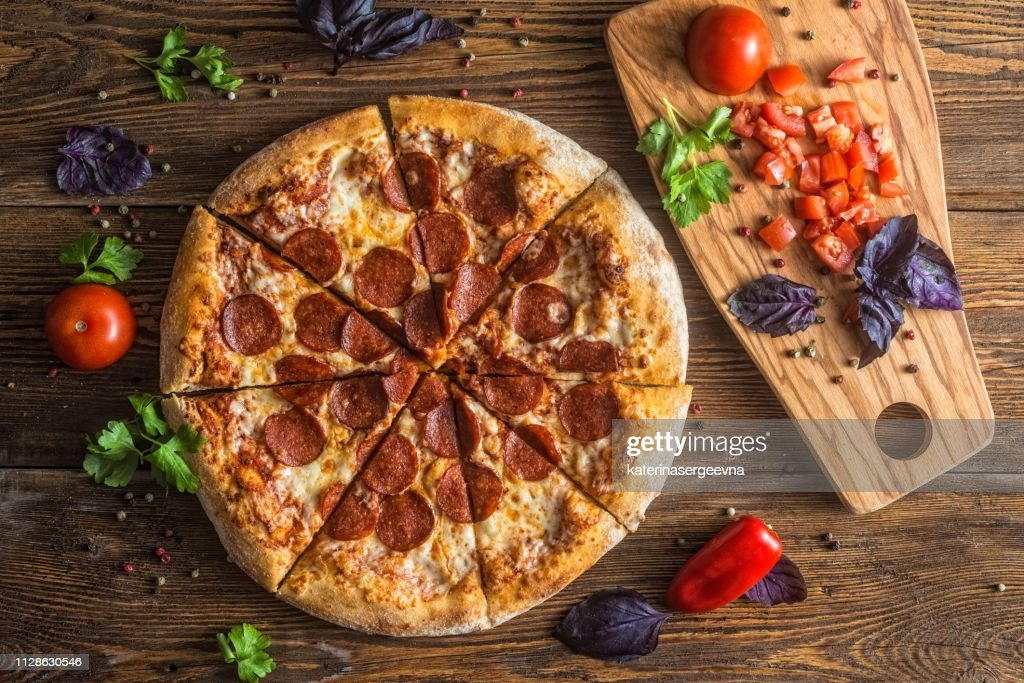 Pizza with cheese, pepperoni, chicken and pepper, a slice for a gourmet dinner : Stock Photo