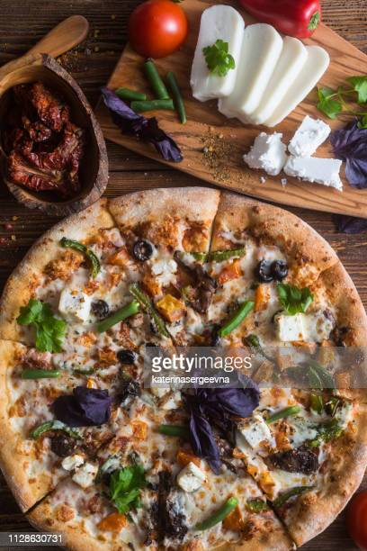 pizza with cheese, pepperoni, chicken and pepper, a slice for a gourmet dinner - vegetarian pizza stock pictures, royalty-free photos & images