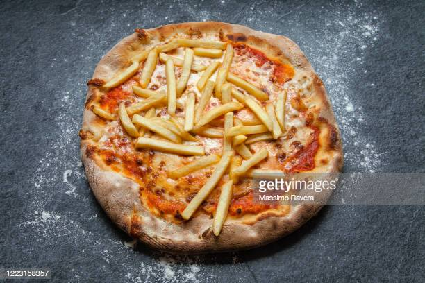 pizza with french fries - prepared potato stock pictures, royalty-free photos & images