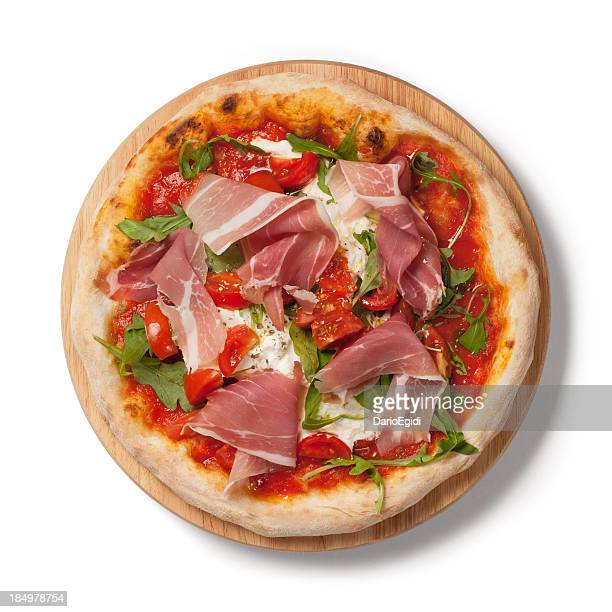 Pizza with  fresh tomatoes, arugula, Parma ham on wodden plate