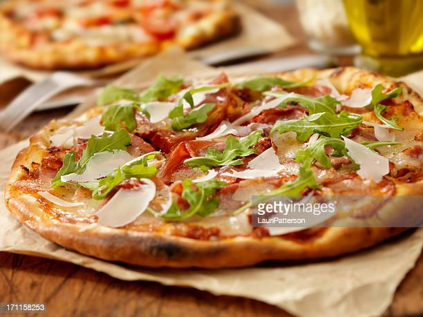 pizza with ham - arugula stock pictures, royalty-free photos & images