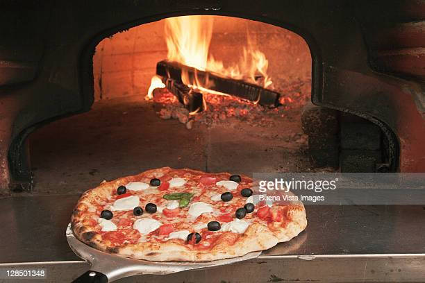 pizza with olives out of wood oven