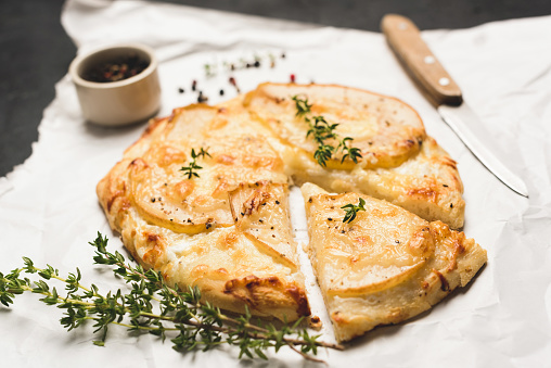 Pizza with pear, cheese and thyme 1033058256