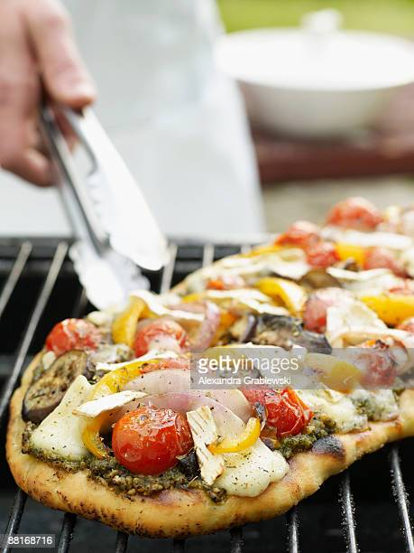 pizza with pesto , eggplant , and cherry tomatoes - pesto stock pictures, royalty-free photos & images