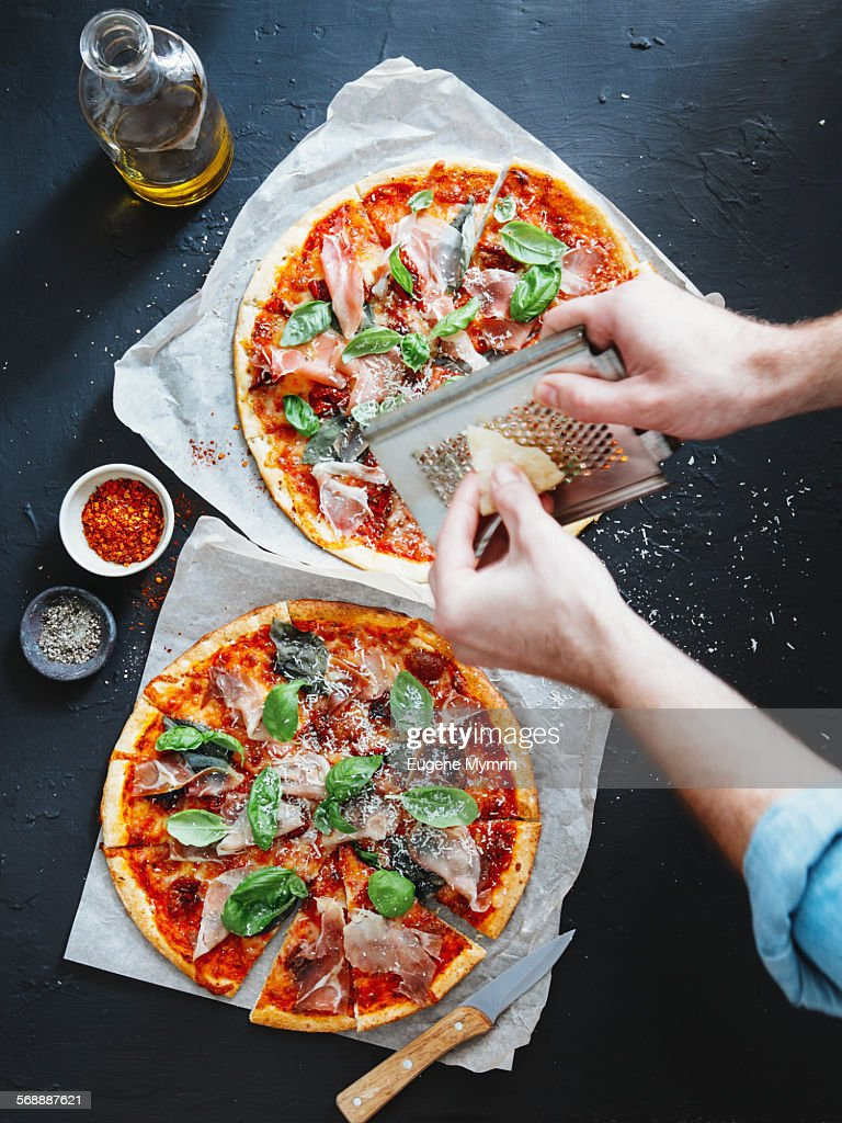 Pizza with prosciutto, basil and parmesan cheese : Stock Photo
