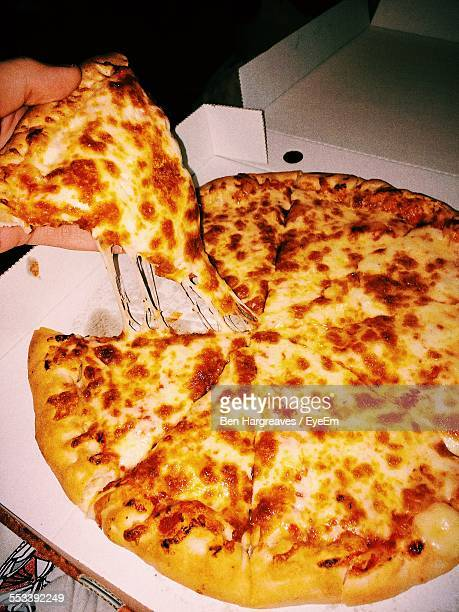 Pizza With Slice In Hand