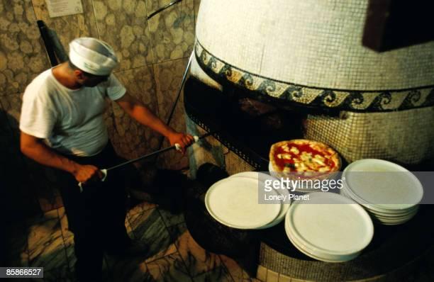 Pizzaiolo at work at Pizzeria Trianon.