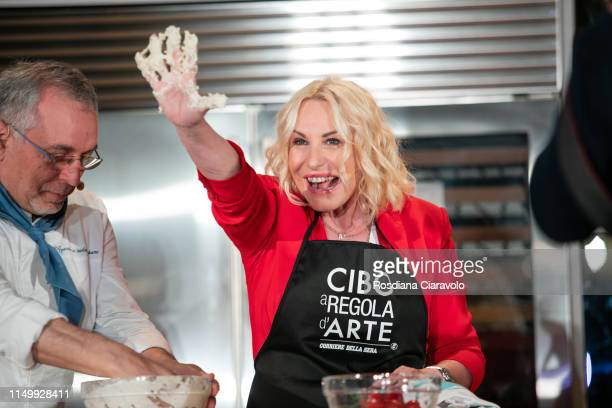 Pizzaiolo Enzo Coccia and Antonella Clerici make pizza margherita during the Cibo A Regola D'Arte 2019 at Fabbrica del Vapore on May 17 2019 in Milan...