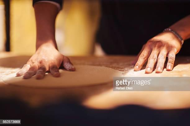 Pizzaiolo working pizza dough