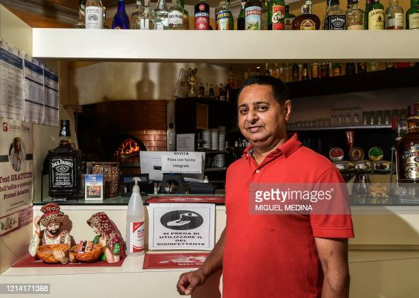 Pizzeria owner and Indian-Italian cook Gurcharan Singh poses at his restaurant on May 20, 2020 in Codogno, southeast of Milan, one of the villages at...