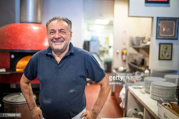 pizzeria owner smiling - italian culture stock pictures, royalty-free photos & images