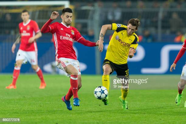 Pizzi of Benfica and Erik Durm of Borussia Dortmund battle for the ball during the UEFA Champions League Round of 16 Second Leg match between...