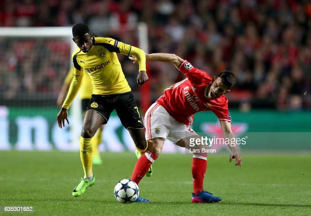 Pizzi of Benfica battles for the ball with Ousame Dembele of Dortmund during the UEFA Champions League Round of 16 first leg match between SL Benfica...