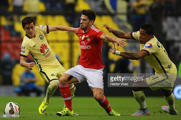 Pizzi of Benfica struggles for the ball with Michael Arroyo and Francisco Rivera of America during a match between America and Benfica as part of the...