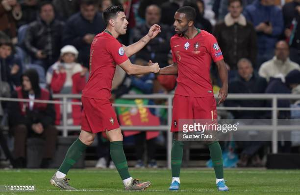 Pizzi of Portugal and SL Benfica celebrates with teammate Ricardo Pereira of Portugal and Leicester City after scoring a goal during the UEFA Euro...
