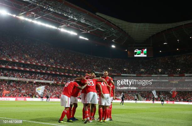 Pizzi of SL Benfica celebrates with teammates after scoring a goal during the Liga NOS match between SL Benfica and Vitoria SC at Estadio da Luz on...