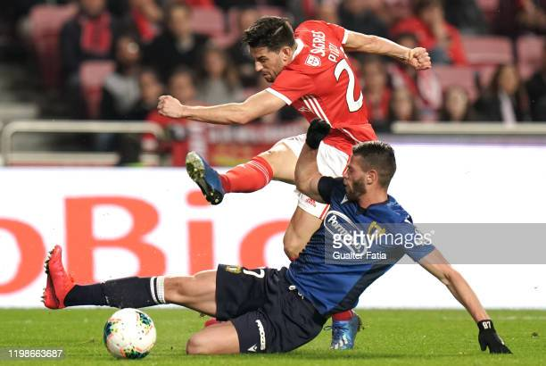 Pizzi of SL Benfica with Patrick William of FC Famalicao in action during the Taca de Portugal match between SL Benfica and FC Famalicao at Estadio...