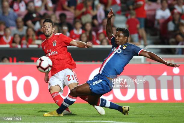 Pizzi of SL Benfica with Vitor Costa of Desportivo das Aves in action during the Liga NOS match between SL Benfica and CD Aves at Estadio da Luz on...