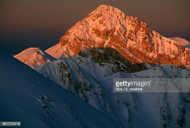 Pizzo Cefalone peak under the snow at dawn, seen from the Duca degli Abruzzi mountain hut, Campo Imperatore, Gran Sasso and Monti della Laga National...