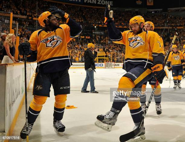 Subban of the Nashville Predators chigh fives teammate Yannick Weber after a 41 victory in Game Four of the Western Conference First Round against...