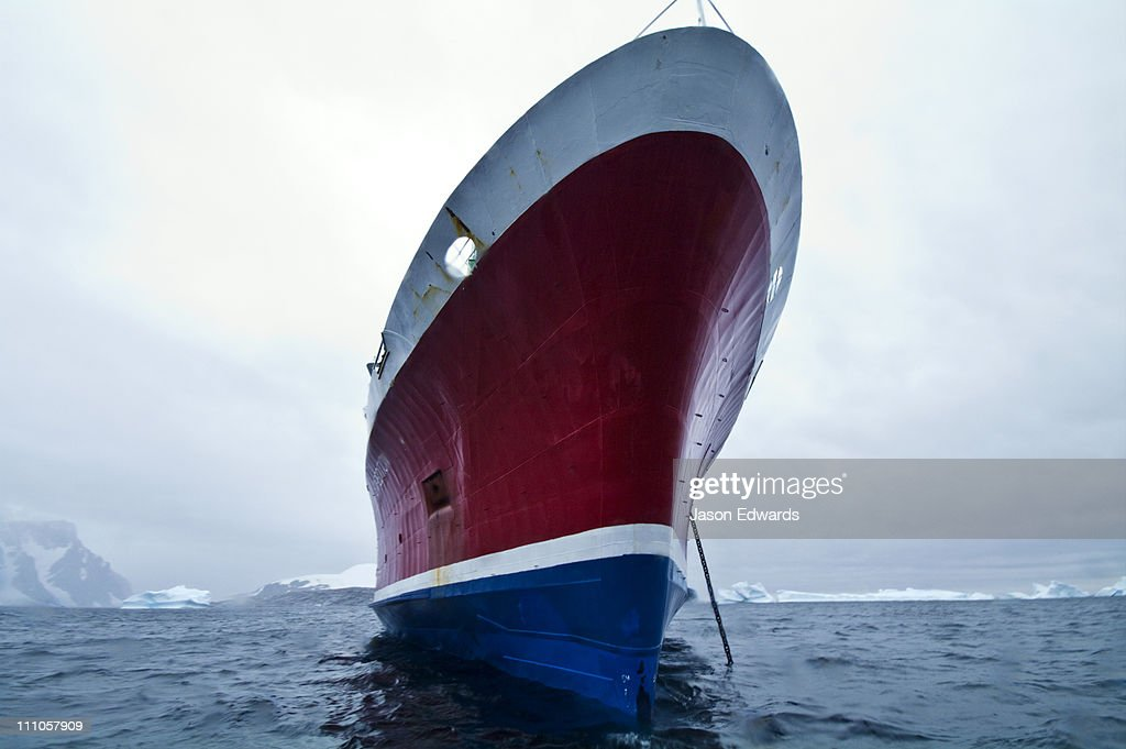 The enormous ice strengthened bow of an ecotourism ship in Antarctica. : Stock Photo