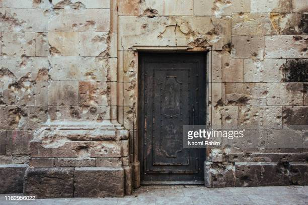 plaça de sant felipe neri in barcelona's gothic quarter with shrapnel damage from the spanish civil war - gothic stock pictures, royalty-free photos & images