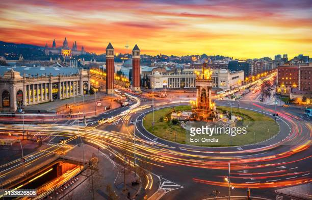 plaça d'espanya (plaza de españa - spain square) long exposure at sunset in barcelona - traffic stock pictures, royalty-free photos & images