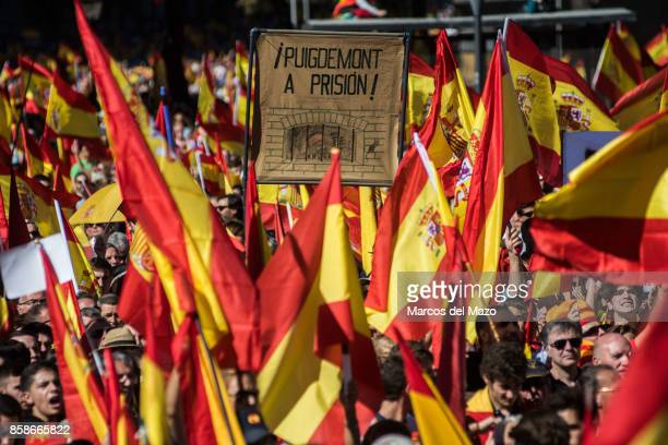 A placard against Catalan President Puigdemont during a demonstration demanding the unity of Spain and against the independence of Catalonia