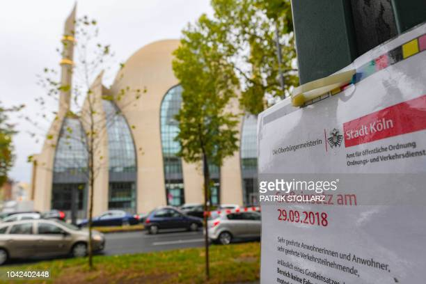 A placard announces a major operation on behalf of the visit of the Turkish President in front of Cologne's Central Mosque run by GermanTurkish...