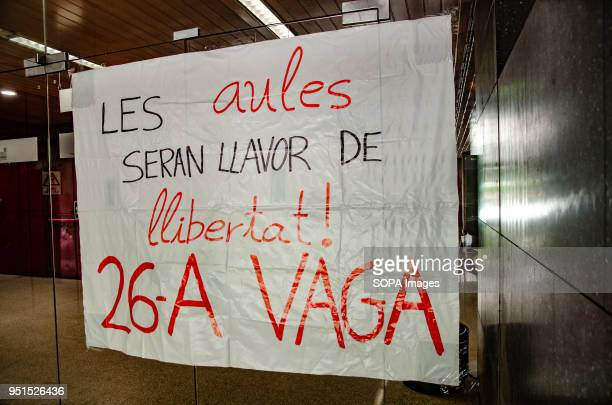 A placard announcing the strike seen at the door of the Central University of Barcelona Thousands of Catalan university students have demonstrated in...