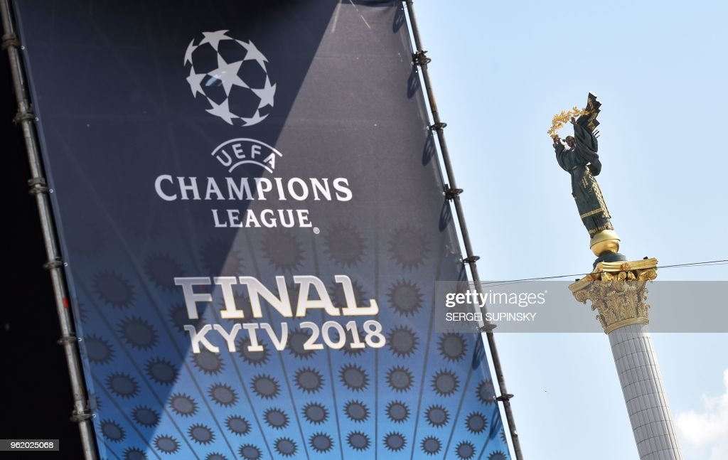 TOPSHOT - A placard bearing the logo of the UEFA Champions League Cup final is displayed at the fan zone in Kiev on May 24, 2018, ahead of the 2018 UEFA Champions League Cup football match between Real Madrid and Liverpool FC next May 26 at the Olimpiyskiy Stadium.