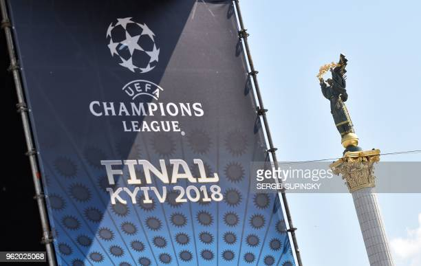 TOPSHOT A placard bearing the logo of the UEFA Champions League Cup final is displayed at the fan zone in Kiev on May 24 ahead of the 2018 UEFA...
