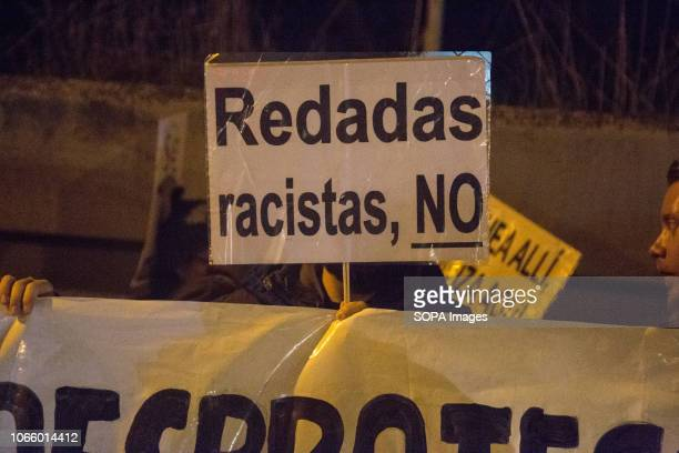 Placard calling for an an end raids on immigrants seen during a protest in front of the Immigration Detention Centre in Madrid Protesters were...