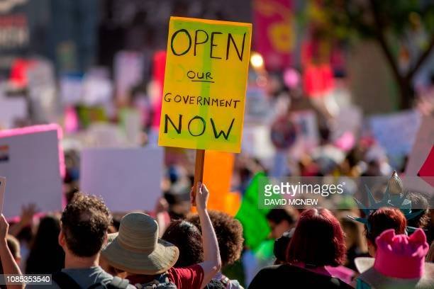 Placard calls for an end to the partial government shutdown during the Third Annual Women's March LA in downtown Los Angeles, California on January...
