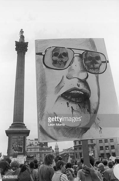 A Placard depicting South African State President P W Botha with skulls for eyes and with blood dripping from his mouth at an antiapartheid rally in...