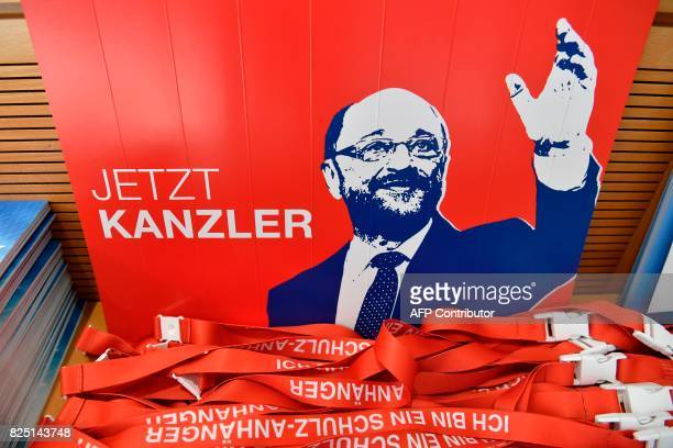 A placard featuring SPD chairman and candidate for chancellery Martin Schulz reading 'now chancellor' and campaigning material is displayed on August...