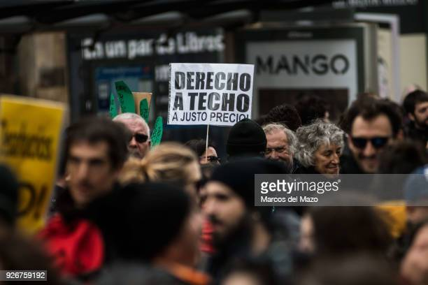Placard for the right of housing during a demonstration where thousands marched to the Governments Party headquarters to protest for the right of...