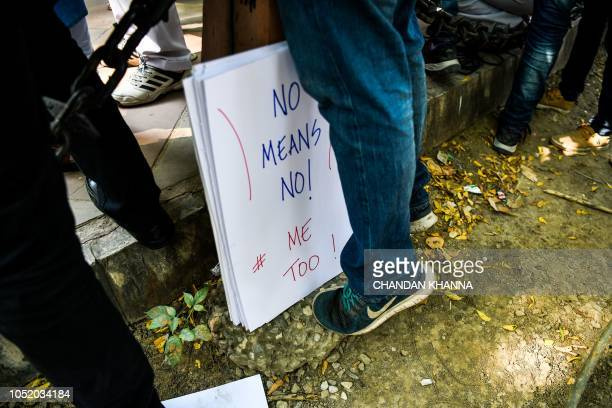 A placard is kept next to an Indian journalist at a protest against sexual harassment in the media industry in New Delhi on October 13 2018 India's...
