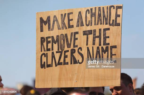 Placard is seen as Manchester United supporters protest against the Glazer ownership during a protest against the club's ownership, outside Old...