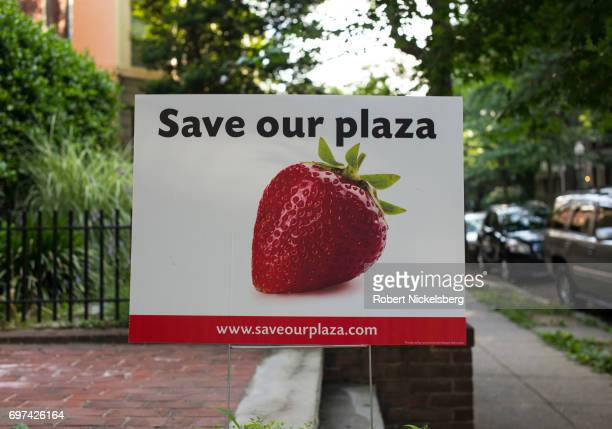 "Placard on a private residence promotes saving a triangle of land known as ""the Plaza,"" owned by the SunTrust Bank June 10, 2017 in the Adams Morgan..."
