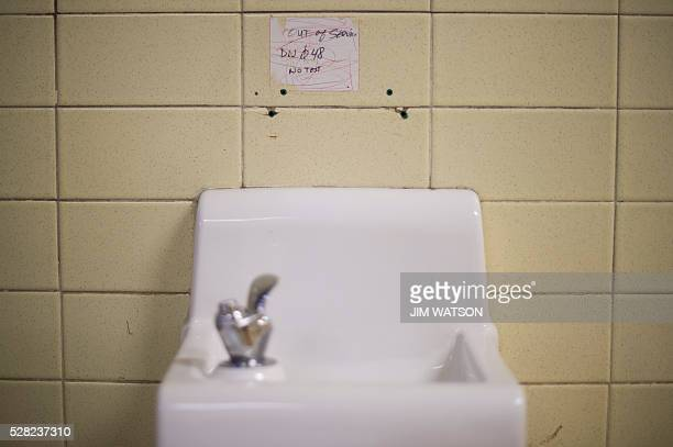 A placard posted above a water fountain warns against drinking the water at Flint Northwestern High School in Flint Michigan May 4 where US President...