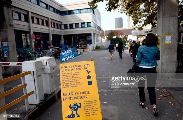 A placard reading 'alcool is prohibited' as a woman enters 'Les Grands Voisins' site on October 18 2017 in Paris Former SaintVincentdePaul Hospital...