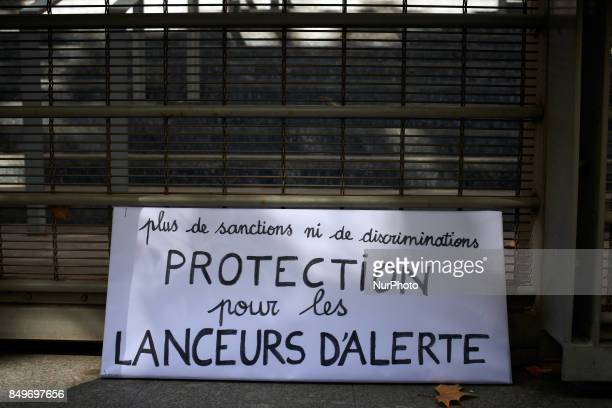 A placard reading 'no more sanctions nor discriminations protection for whistleblowers' during the hearing of Celine Boussie French whistleblower and...