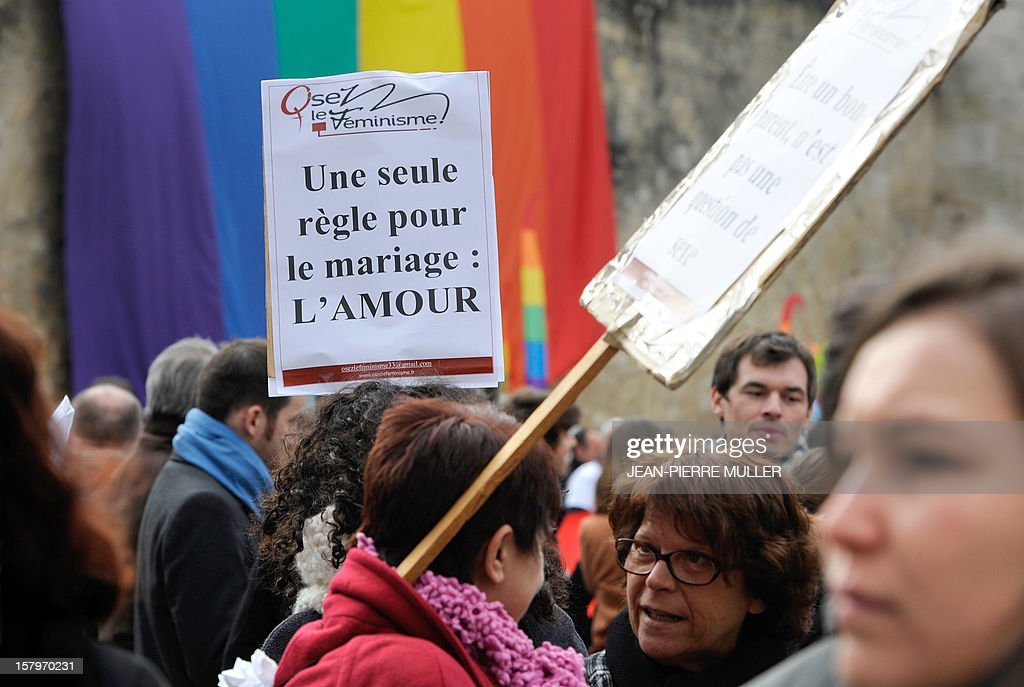 A placard reading 'One single rule for marriage: love' is displayed during a demonstration to support same sex marriages in Bordeaux, south eastern France on December 8, 2012.